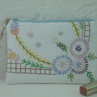 Zipped make up bag using upcycled embroidery