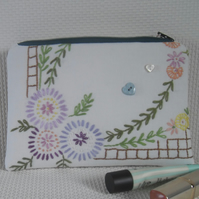 Make up bag using upcycled embroidery