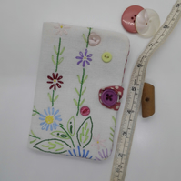 Sewing needle case with repurposed embroidery and spotty fabric