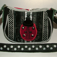 Black, White and silver  Ladybird purse with long adjustable strap