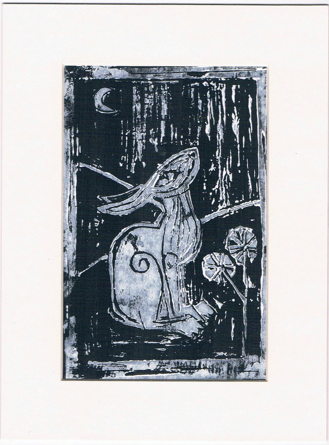 lino cut print hare white on black