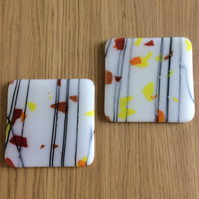 Pastel flakes on white coasters  (0328)
