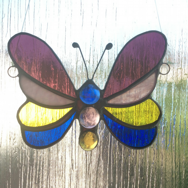 Banded stained glass butterfly suncatcher. (0560)
