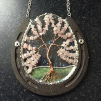 Horseshoe with rose quartz tree of life