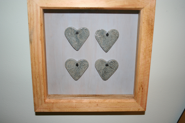 Wooden frame with hand made ceramic small blue textured valentine hearts