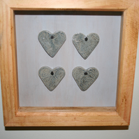 Wooden frame with hand made ceramic small blue textured hearts