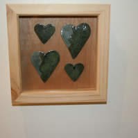 Wooden frame with handmade green speckled blue ceramic hearts Mothers day gift