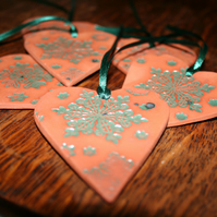 Handmade ceramic green heart embossed with snow flake design decoration