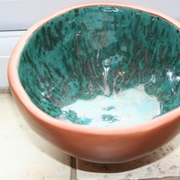 Handmade ceramic terracotta footed glazed metallic green bowl