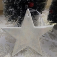 Handmade porcelain paper clay star hanging decoration with mother of pearl lustr