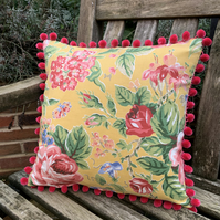 Yellow floral cushion cover with Pom Pom trim