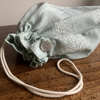 Embroidered linen drawstring bag for shoes or delicates