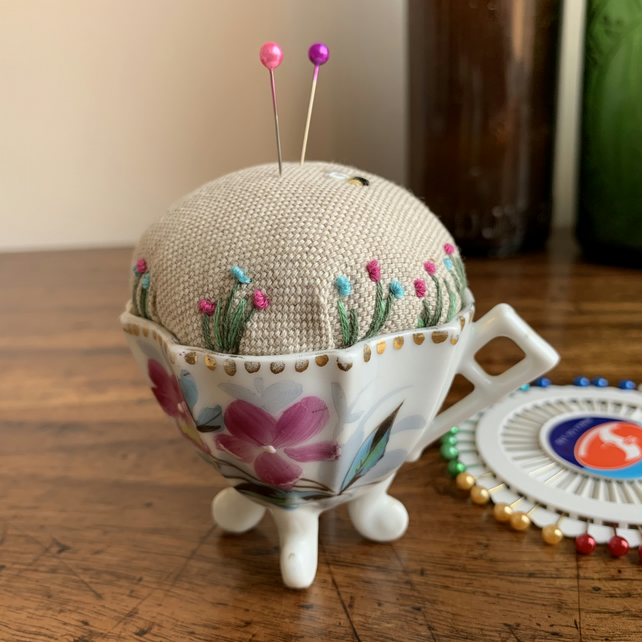 Old china cup embroidered pin cushion