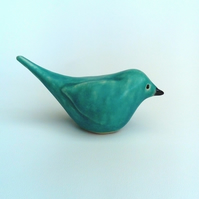 Clay bird sculpture in matt turquoise