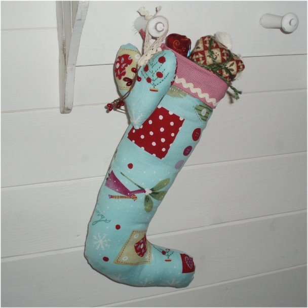Christmas stocking with mouse and  matching heart decoration.