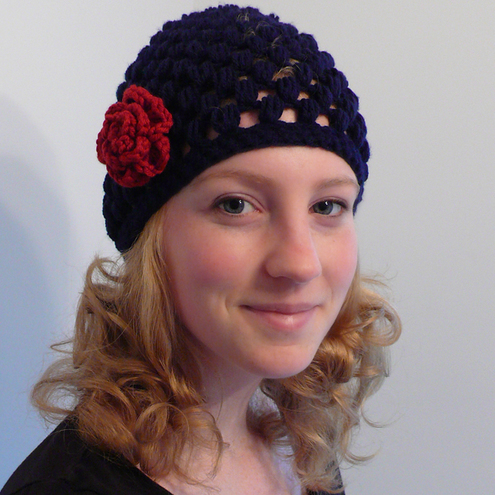 Navy blue knitted hat with red flower