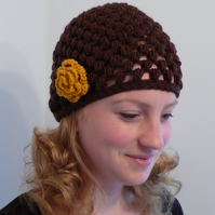 Chocolate brown knitted hat with mustard yellow flower