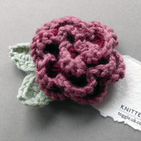 Knitted pink flower brooch