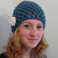 Petrol blue knitted had with cream flower