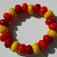 Set of 21 Yellow Red and Orange Handmade Lampwork Spacer Beads