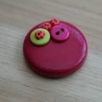 Pink & Green Button PVC Badge