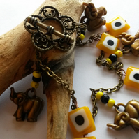 Bracelet Elephants with yellow and black beads