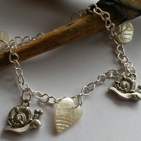 Bracelet - mother of pearl leaves and silver snails