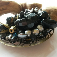 Brooch in Shades of grey, black and bronze