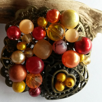 Brooch Sunset tones with heart