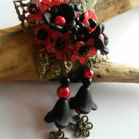 Brooch Black and Red Festivity