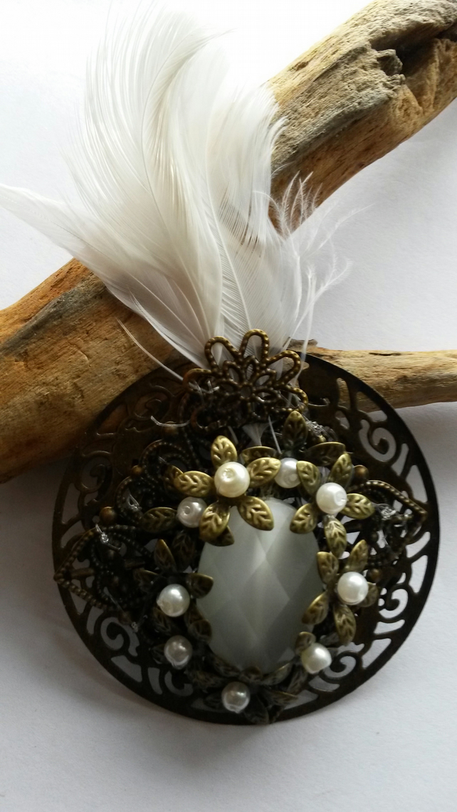 Brooch White and Bronze with feather