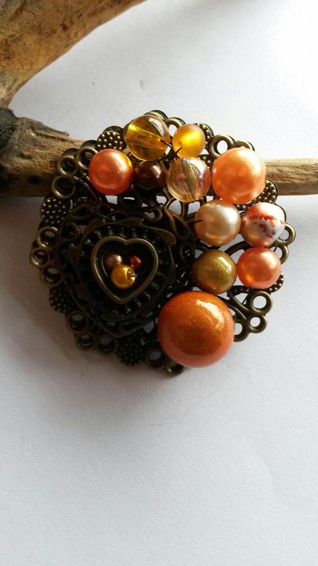 Brooch two orange hearts