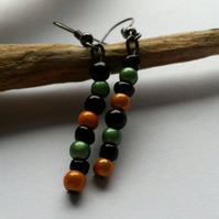 "Earrings ""cockalorum"" Orange, green and black beaded earrings."