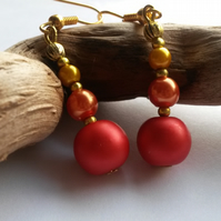 Of October's Spheres,  bright orange beaded earrings