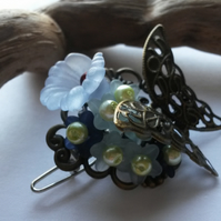 Hair Clip Butterfly and the blue flowers
