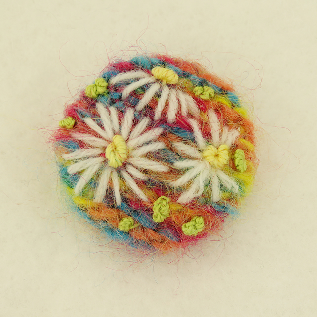 Daisy Brooch embroidered on knitted multi citrus background