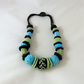 Bead string - knitted, crocheted, and fabric embroidered black, lime turquoise