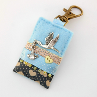 blue new baby gift - stork and baby - nappy bag charm