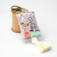 Ballerina bag charm hand sewn mixed textile key clip with dangle tassel