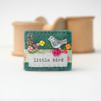 little bird brooch hand stitched in felt with floral buttons, nature inspired