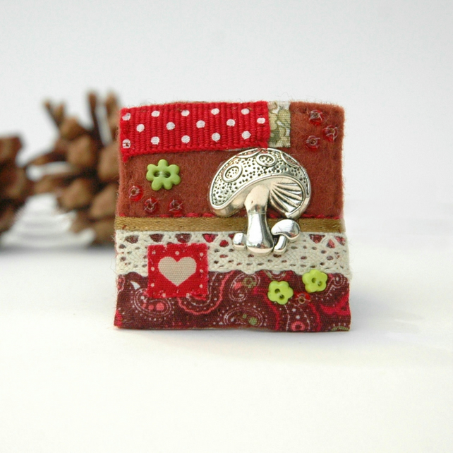 toadstool brooch, decorative textile badge hand stitched in autumn colours