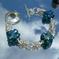 Blue lampwork beads and Sterling  silver bracelet.