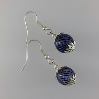 Black and blue swirled hollow glass bead earrings