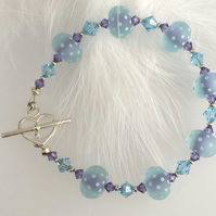 Pale blue and purple lampwork bead bracelet with Sterling silver heart clasp