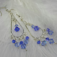 Sterling silver chandelier earrings with blue crystals