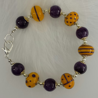 Stunning pumpkin and purple bracelet