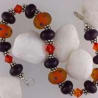 Aubergine and saffron handmade glass bead bracelet