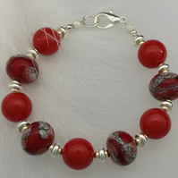 Red beaded bracelet with lobster clasp
