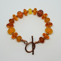 Copper, amber and glass bead bracelet
