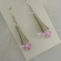 Spiral earrings with pink crystals